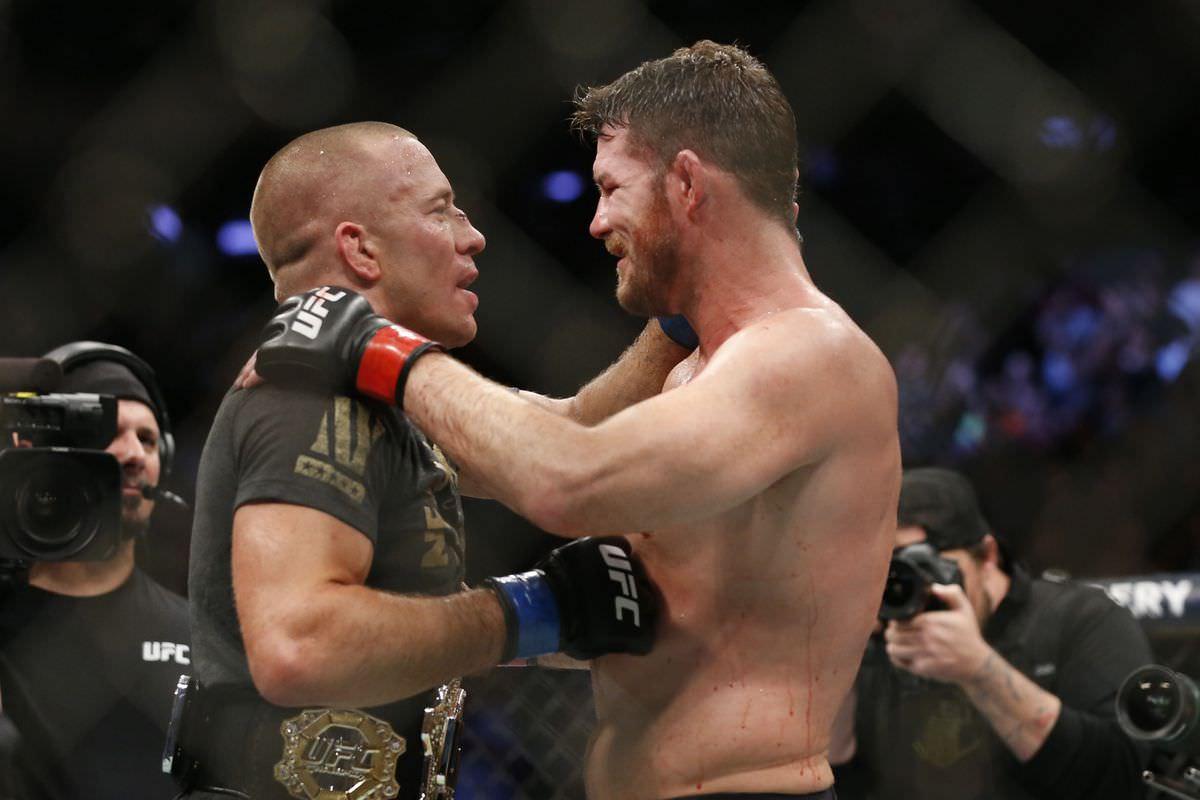 Georges St-Pierre y Michel Bisping tras el combate en UFC 217