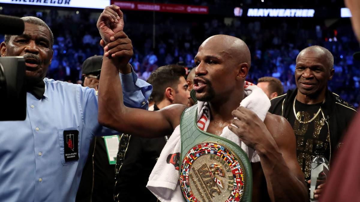 Mayweather con el cinturón de campeón