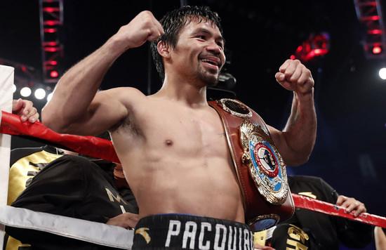 Manny Pacquiao con el cinturón de campeón