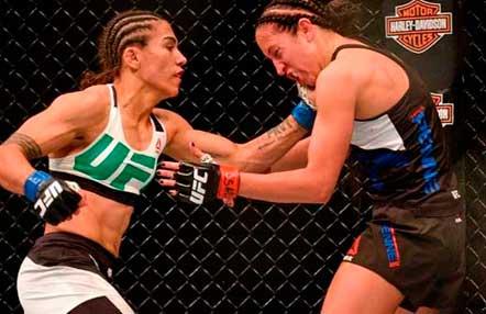 Jessica Andrade y Liz Carmouche durante el primer combate entre lesbianas en la historia de la UFC